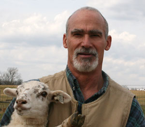 Four Hills Farm owner Jim Mansfield with a ewe lamb